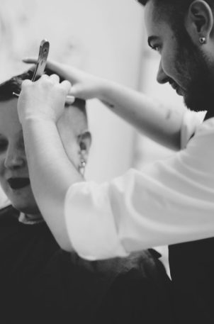 Jessie performs a straight razor shave on a femme's undercut