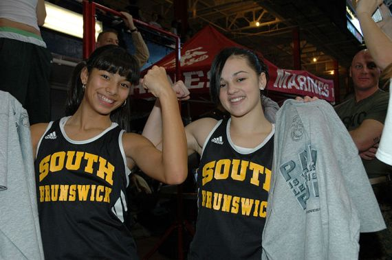 Natalie Negrotti and Jennifer Zelaya of South Brunswick High School in New Jersey flex their muscles after maxing the female flexed arm hang. Sourcece: Cpl. Wil Acosta of the 1st Marine Corps District/Public Domain