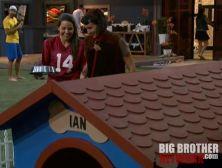 Danielle leading Ian on the leash - Big Brother 14
