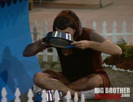 Ian drinking from the dog bowl - Big Brother 14