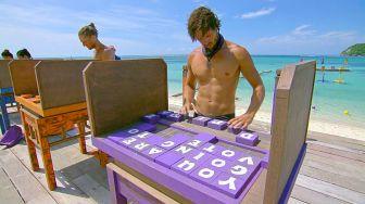 Hayden works his challenge puzzle
