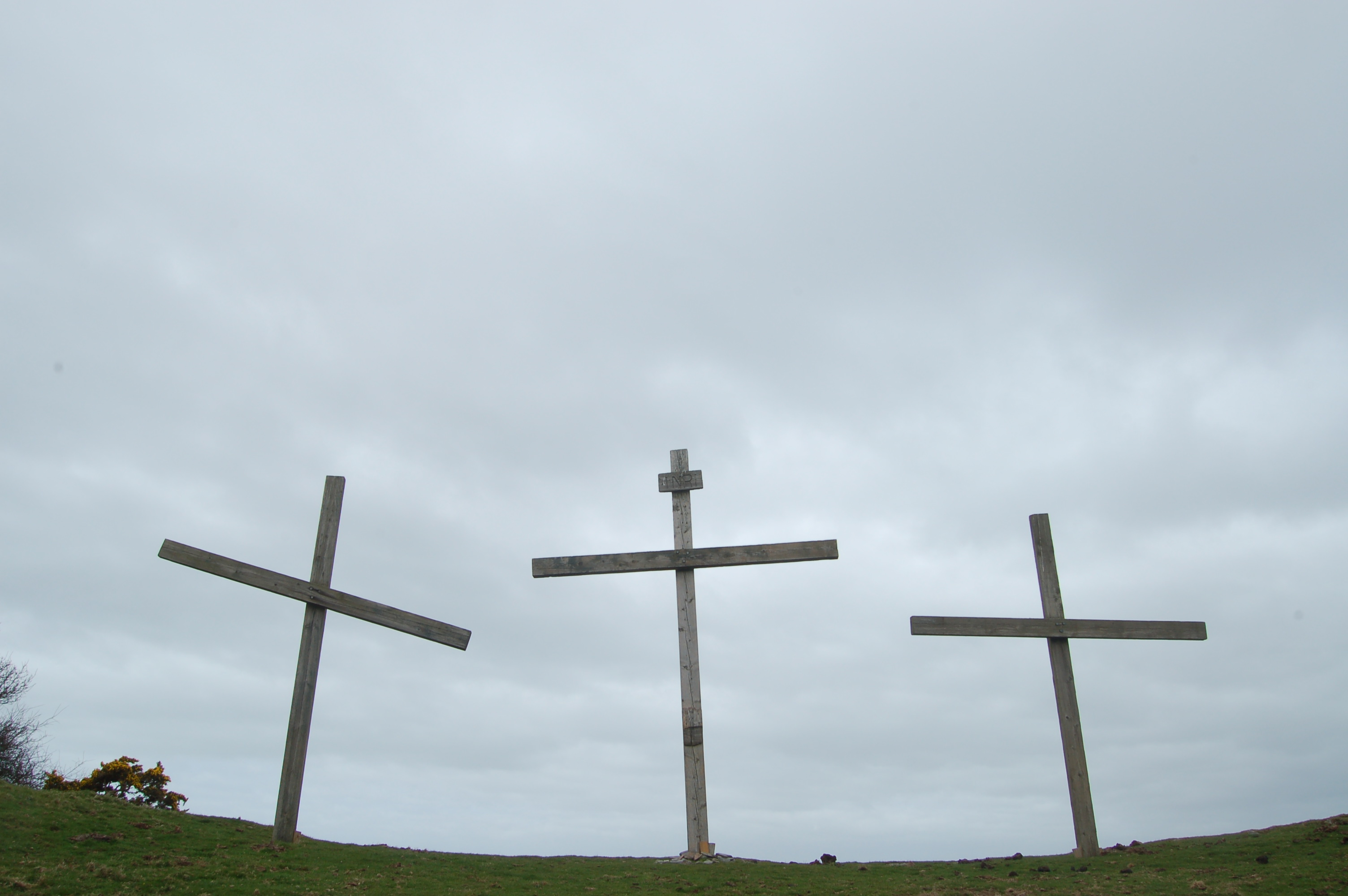 The Three Crosses at Lee Abbey set against a background of sky