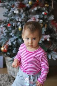 kid and christmas tree