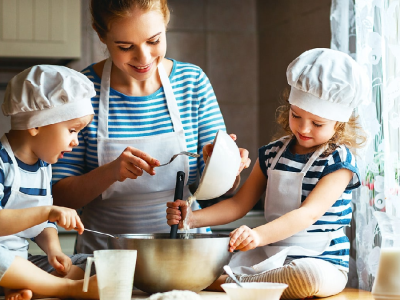Children cooking with an adult.