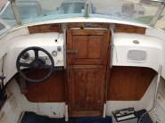 Port helm and door to cuddy cabin
