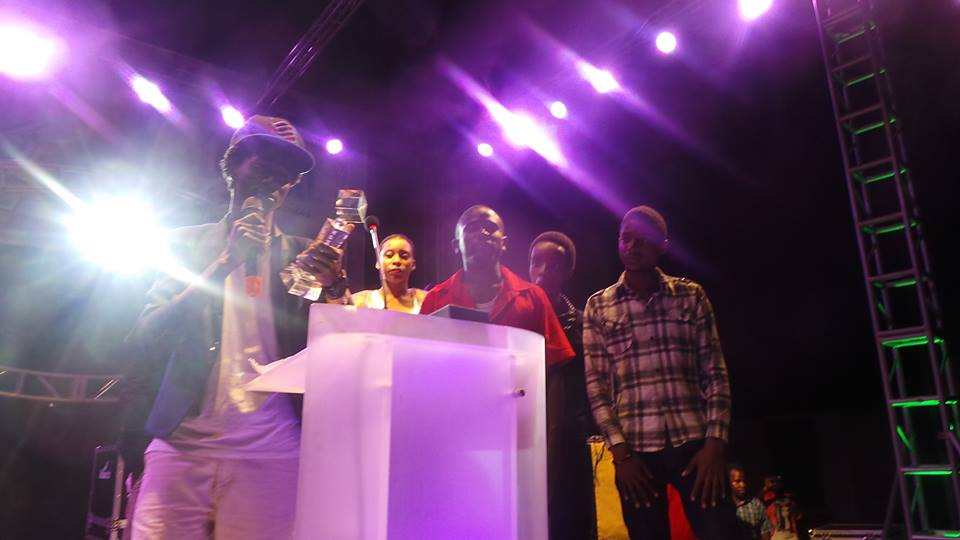 The BigEyeUg team accepting their award.
