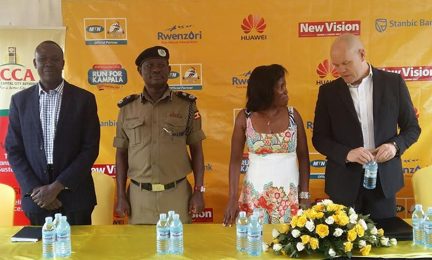 MTN CEO Brian Gouldie chats with the KCCA ED Jennifer Musisi at the Launch of the MTN Kampala marathon 2015 edition at Nsambya Police Primary School