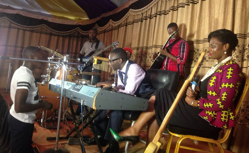 Pastor Wilson Bugembe preparing for the concert with his team.