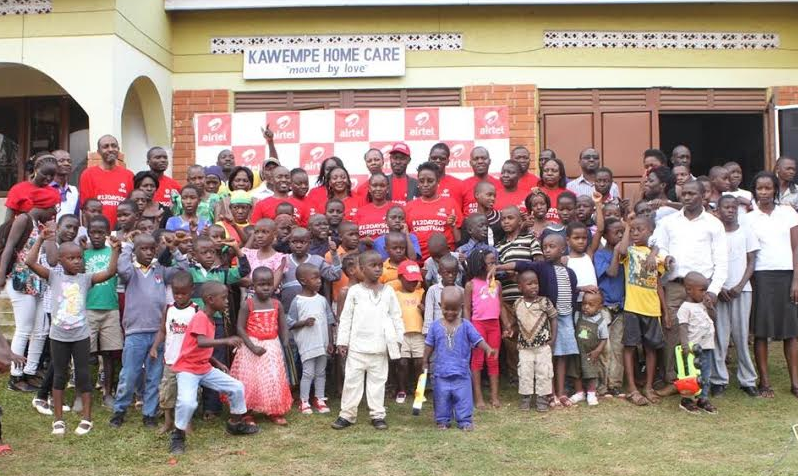 Airtel uganda staff pose with the Children of Kawempe Home Care after a Painting Activity