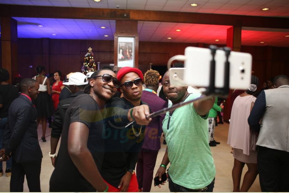Professor Big Eye taking selfies at the Abryanz Fashion and Style Awards