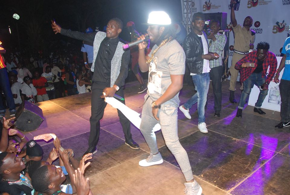 Chameleone and Bebe Cool entertaining the crowd at UG MIX Party