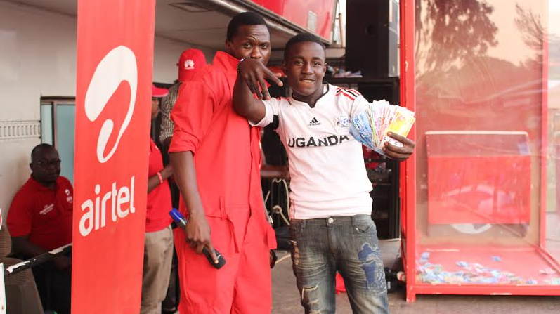 One of the lucky winners of the Yoola Amajja with Airtel Money poses with his money.