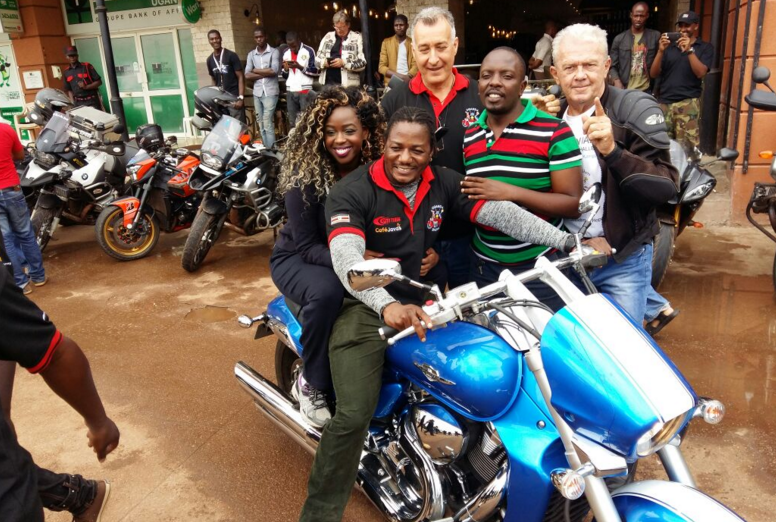 Angella Katatumba poses with bikers.