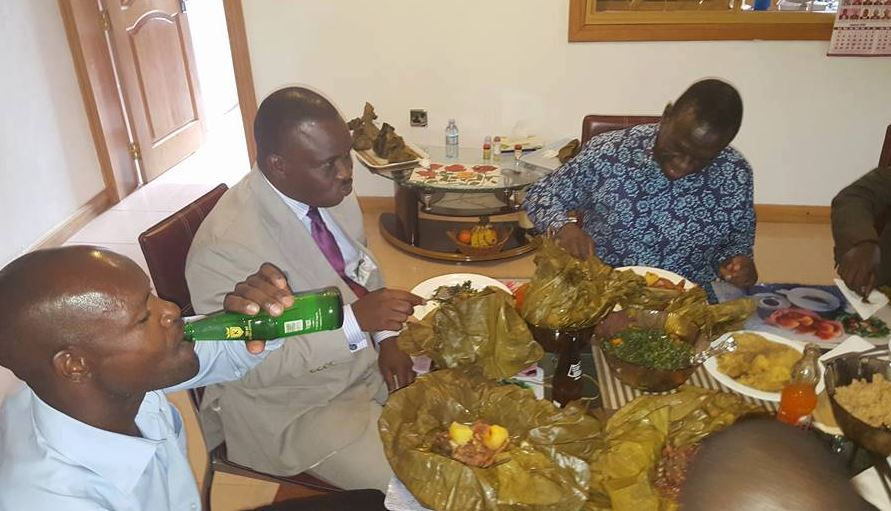 Kiiza Besigye enjoys a meal with Erias Lukwago