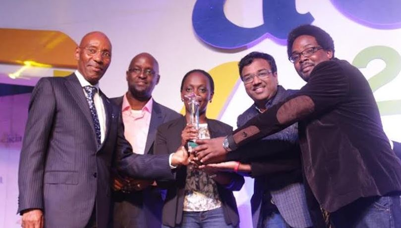 Airtel Uganda team led by Legal and Regulatory Director Dennis Kakonge receive an award from UCC Executive Director Godfrey Mutabazi at the 2016 ACIA awards.