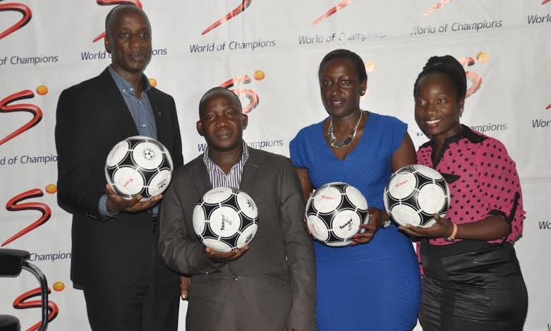 (L-R) MultiChoice Uganda, General Manager Charles Hamya, DStv Sales Manager John Kiryowa, DStv Marketing Manager Phoebe Nakabazzi and MultiChoice PR & Communications Manager Tina Wamala officially unveil the Euro 2016 tournament which will be available on SuperSport 3 (DStv channel 223) and SuperSport 4 (DStv channel 204) and on SuperSport 11 (DStv channel 211) and SuperSport 12 (DStv channel 212) for DStv Compact subscribers.