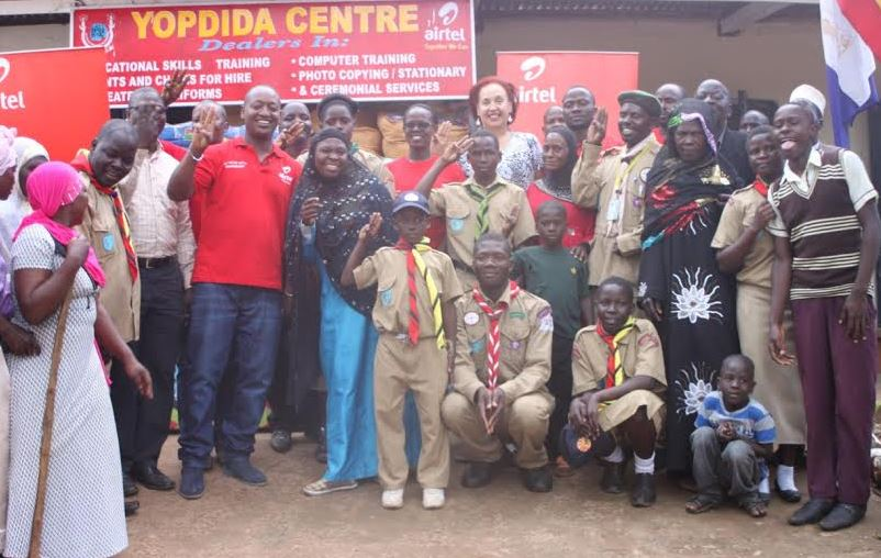 Members of YOPDIDA, Dr Maggie Kigozi and Airtel Staff pose for a group photo after Airtel Uganda handed over essential equipment.