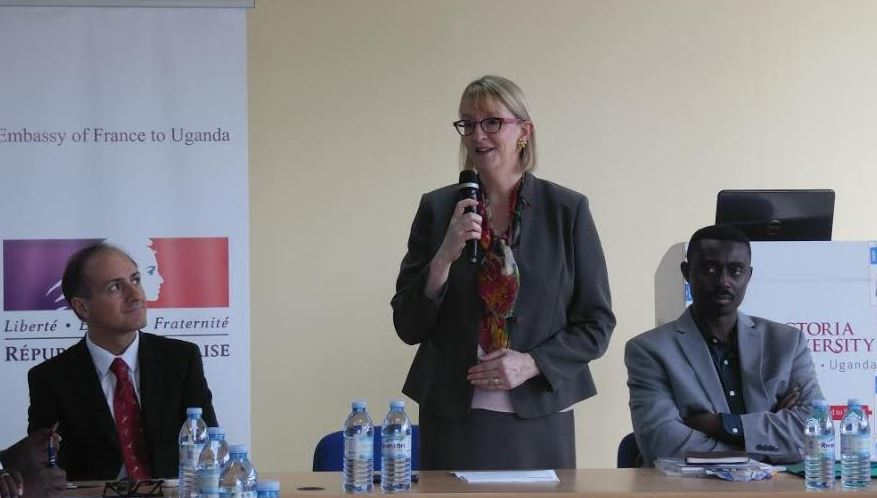 H.E Sophie Makame, Ambassador of France to Uganda, giving her remarks at the opening of a workshop for diplomats on Friday. Looking on is Mr. Alessandro GIORGINI (L), and Dr. Stephen Robert Isabalija, Vice Chancellor of Victoria University (R).