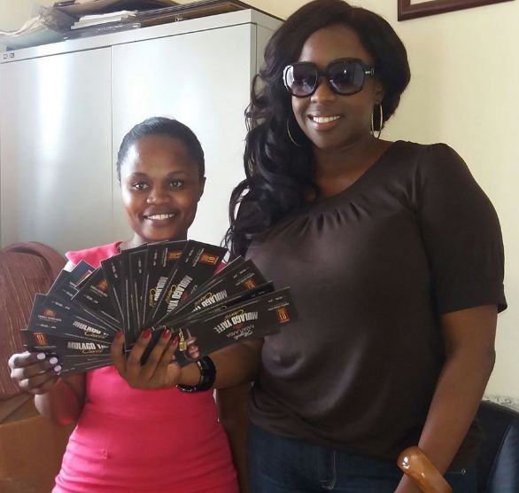 Angella Katatumba delivers tickets to cancer patients