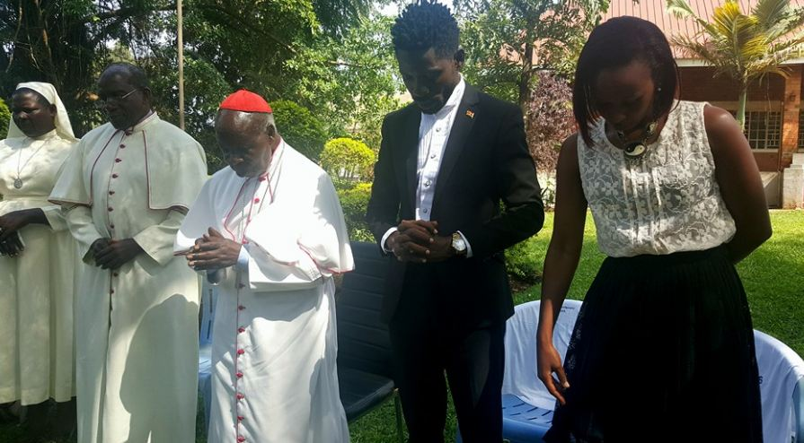 Bobi Wine and his wife Barbie receive prayers from Cardinal Wamala