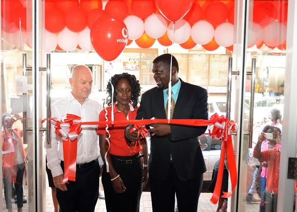 (R-L) Issa Sekitto- Spokesperson KACITA, Deborah Namisango- Store Manager and Allan Richardson- CEO Vodafone Uganda officially open the new Luwum Street Experience store.