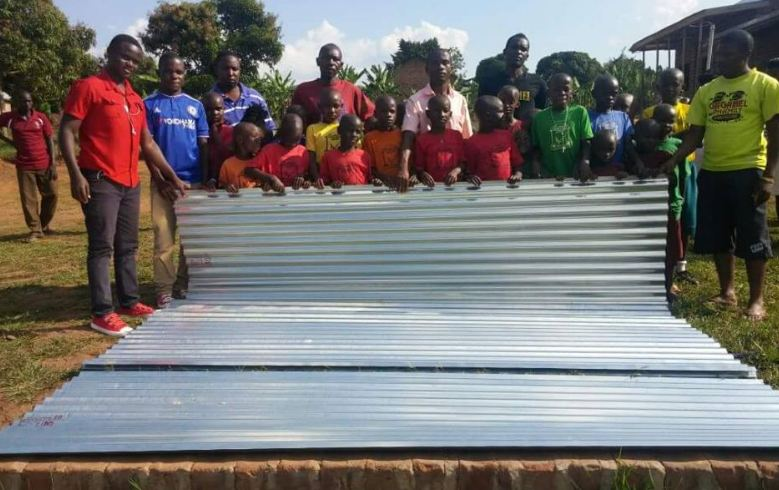 Bebe Cool donates iron sheets to St Mary primary school
