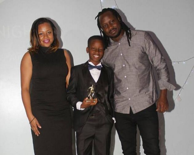 Alpha Thierry Ssali poses for a photo with his dad and mum after receiving player of the season award at the Proline Soccer academy awards gala.