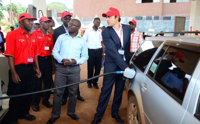 Florentin de Loppinot, the Managing Director Total Uganda fuels a vehicle at the launch of Total Excellium.