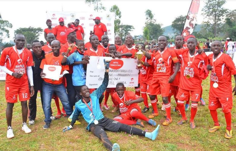 ARS 2016 Buganda region boys' winning team Wakiso Hill S.S pose with trophy and dummy cheque worth UGX1,000,000.