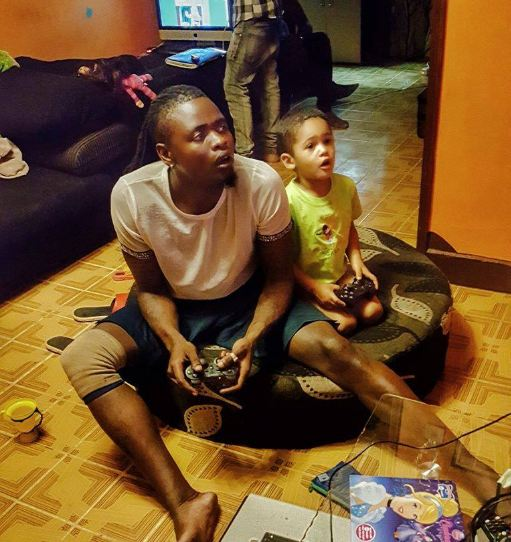 Pallaso plays with his son
