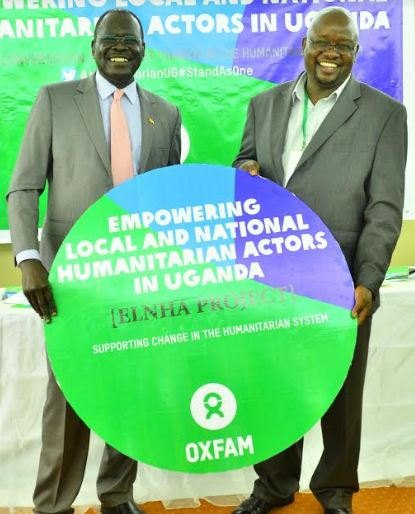Hon. Hillary Onek, Minister for Disaster Preparedness and Refugees and Peter Kamalingin, Oxfam Uganda Country Director launch the Empowering Local and National Humanitarian Actors Project (ELNHA).