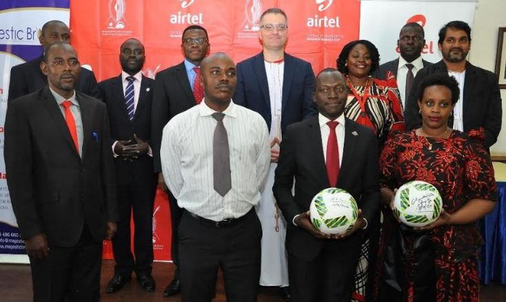 Airtel Uganda officials led by MD Anwar Soussa, and Buganda Kingdom officials led by Katikiro, Owek. Peter Mayiga pose for a group photo during the official announcement of Masaza cup sponsorship.