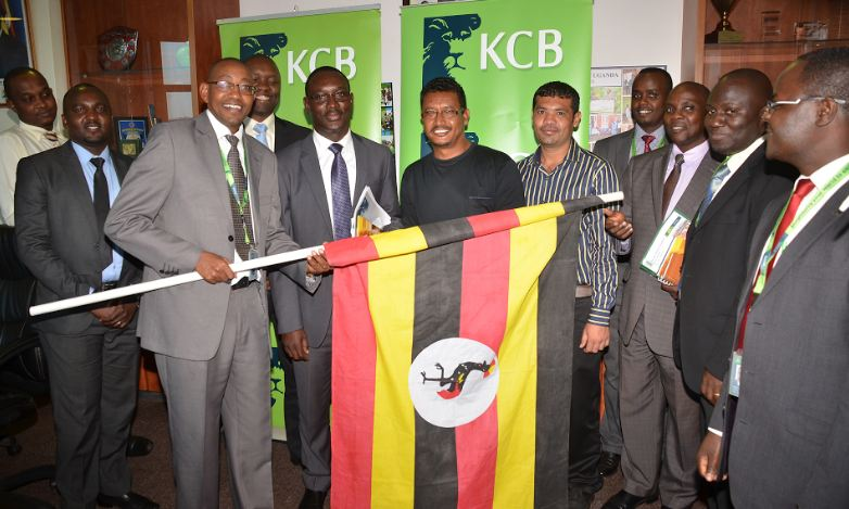 Joram Kiarie (L) Managing Director KCB Bank Uganda together with KCB officials pose with the KCB SMEs who will be travelling to China for a businesses networking trip sponsored by the bank.