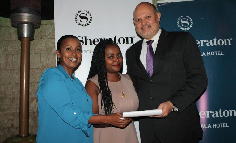 Sheraton Kampala/Djibouti General Manager Jean Philippe Bittencourt handing over vouchers to Ms. Esther Karua (Center) Director at Emi Travel Limited who won a weekend for two at Sheraton hotel, complete with Ugandan message. On the left is Mrs. Naima Abdourahman, Director of Sales and Marketing Sheraton Djibouti.