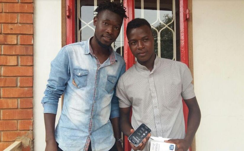 One of the lucky winners of the Coke Studio competition poses for a photo with his Samsung Galaxy J.