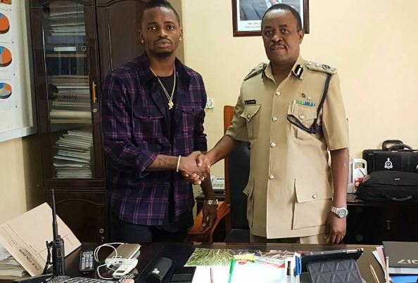 Diamond Platnumz with a police commissioner
