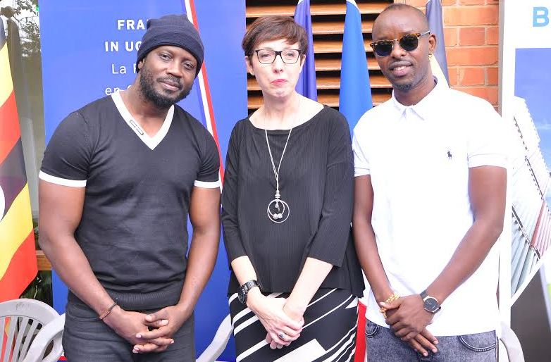 Bebe Cool and Eddy Kenzo pose for a photo with French Ambassador Stephanie Rivoal at the France – Uganda Friendship Week.