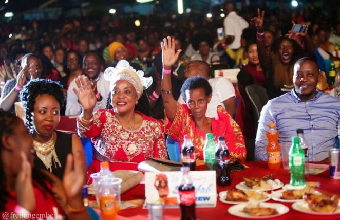 Sheebah Karungi's mum (dark skinned woman raising up her hand) attending one of the singer's past concerts.
