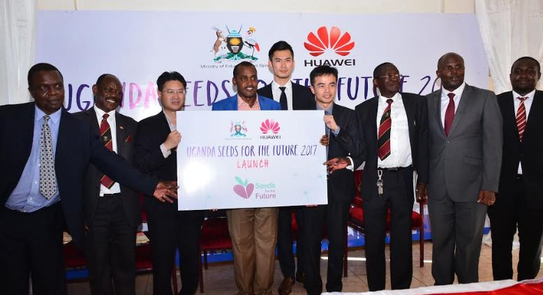 Hon. Frank Tumwebaze, Minister of ICT and National Guidance (M), Mr. Chu Maoming CDM Chinese Embassy to Uganda (L), Mr. Stanley Chyn(R) Huawei Managing Director and other guests launch the Huawei Seeds for the Future 2017