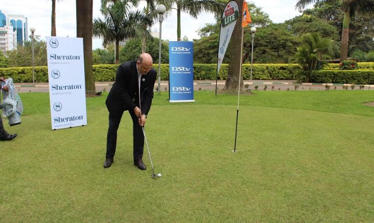 The General Manager of Sheraton Kampala Hotel Mr. Jean Philippe Bittencourt demonstrates teeing off before the media