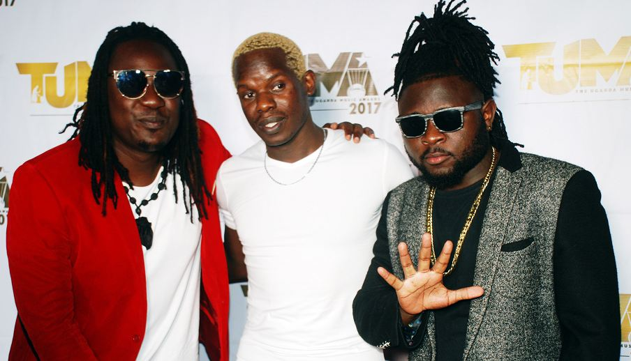 Voltage music duo, Kent & Flosso pose for photo with comedian Afande Kelele (C) at the TUMA nominees party.