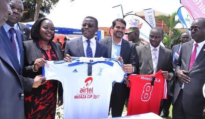 Marketing Director Mr. Indrajeet Singh Kumar, Katikkiro Owek. Charles Peter Mayigga, Airtel's Remmy Kisakye and Buganda officials unveil the jersey that will be used during the Masaza cup.