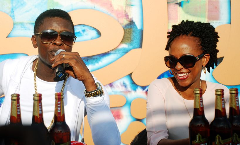 Chameleone addresses media during a press briefing held at UBL offices. Looking on is Juliana Kaggwa, the Marketing manager UBL.