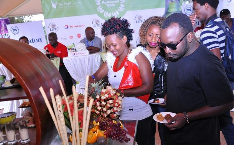Members of the media try out the dessert challenge during the launch of the Kampala Restaurant week.
