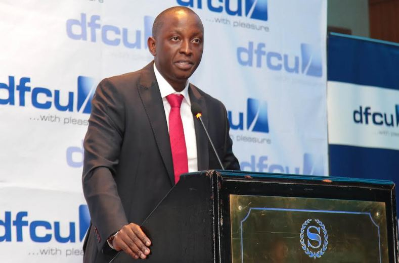 William Sekabembe, dfcu Bank's Chief of Business and Executive Director addresses stakeholders during the release of the bank's release of its consolidated interim financial results