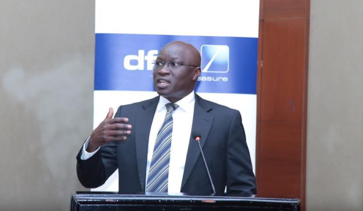 dfcu Bank Uganda's Chief of Business, William Sekabembe gives his remarks during a breakfast event organized by the Bank for Local and international agricultural exporters at Sheraton Hotel, Kampala.