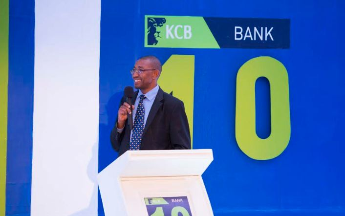 Joram Kiarie (R), the KCB Bank Uganda Managing Director with Dr. Louis Kasekende (C)the Deputy Governor and Bank of Uganda during the bank's 10-year celebration in Uganda.