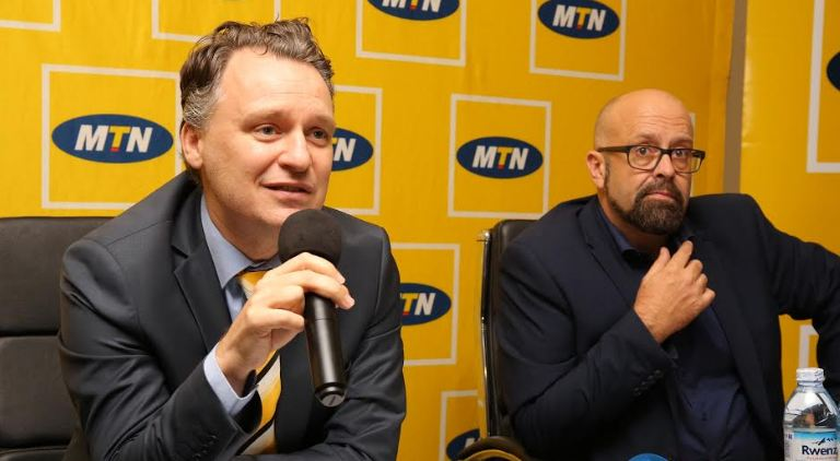MTN Uganda CEO Wim Vanhelleputte (left) addresses the media at the MTN CEO Briefing held at MTN Towers on Tuesday. He is flanked on the right by Olivier Prentout (Chief Marketing Officer).