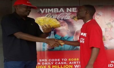 Muwafu receives his cash from CCBA's Simon Kaheru
