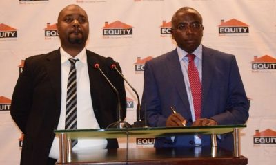 Anthony Kituuka, Executive Director Equity Bank Uganda and Allan Waititu, the Director Special Projects Equity Bank address media during the launch of their biometric banking solution at Kampala Serena Hotel on Tuesday.